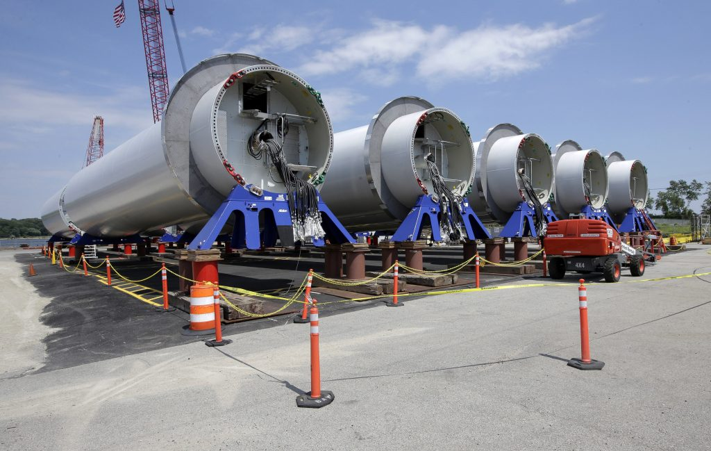 Sections of wind turbine towers sit in rows at a staging site at Port of Providence. (AP Photo/Steven Senne)