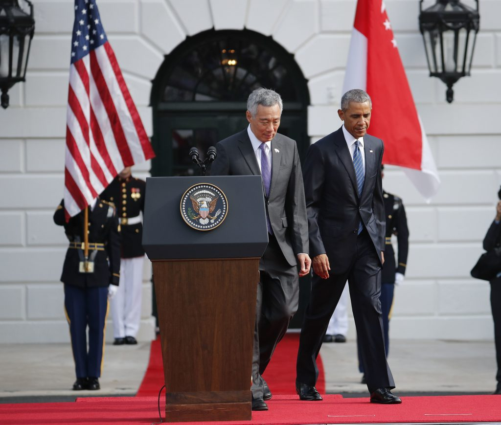 President Barack Obama and Singapore's Prime Minister Lee Hsien Loong walk on stage to begin a state arrival ceremony on the South Lawn of the White House in Washington, Tuesday, Aug. 2, 2016. (AP Photo/Pablo Martinez Monsivais)