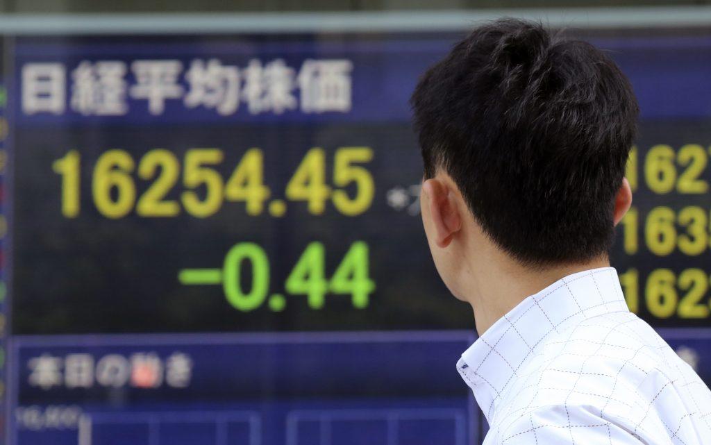 A man looks at an electronic stock board of a securities firm in Tokyo. (AP Photo/Koji Sasahara)
