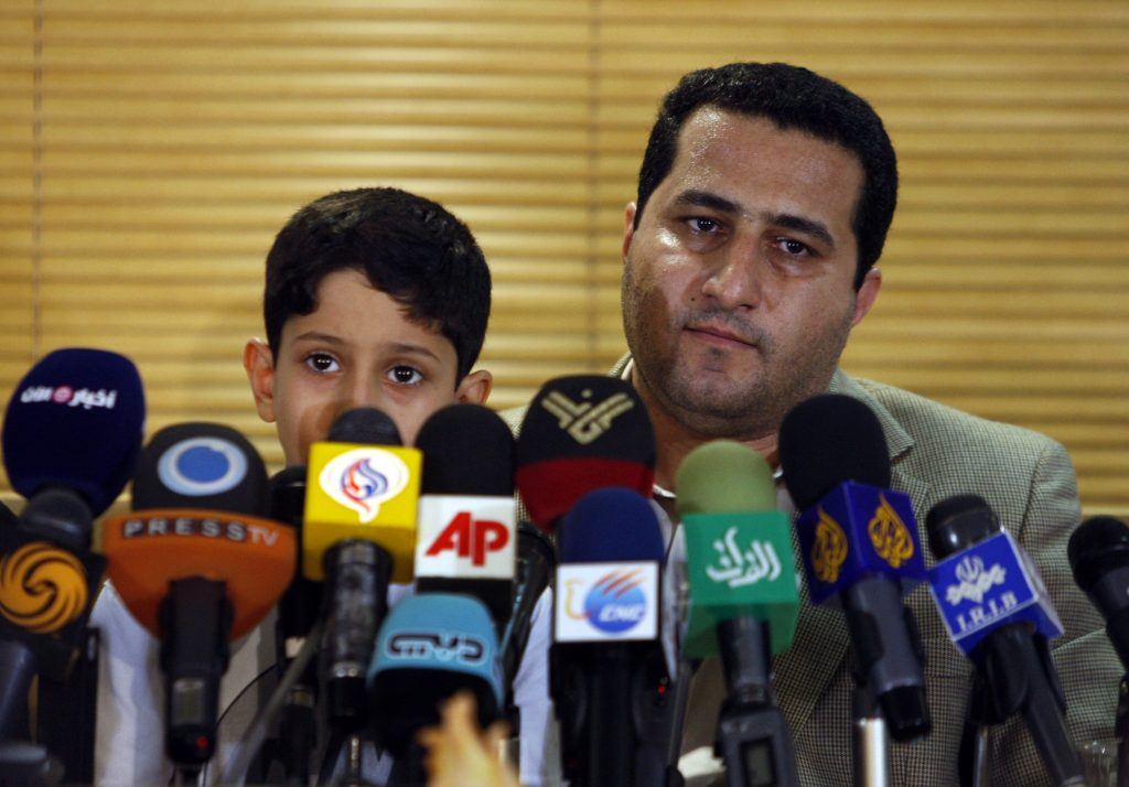 In this 2010 photo, Shahram Amiri, an Iranian nuclear scientist, speaks with journalists at the Imam Khomeini airport, just outside Tehran, Iran, after returning to his homeland from the United States. (AP Photo/Vahid Salemi)