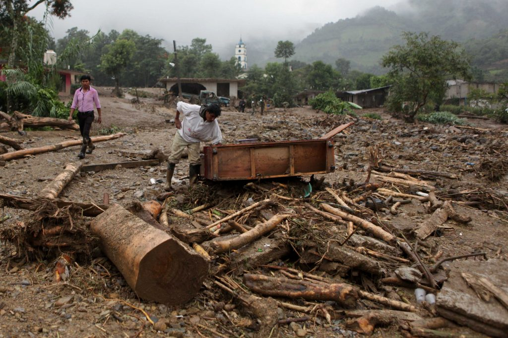A man inspects furniture in the aftermath of a mudslide in Xaltepec, on the mountainous north of Puebla state, Mexico, on Sunday. (AP Photo/Pablo Spencer)