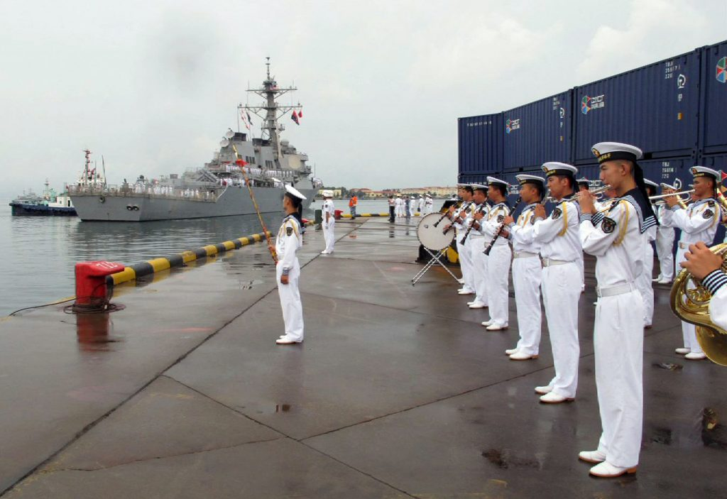 A Chinese military band plays as the guided missile destroyer USS Benfold arrives in port in Qingdao in eastern China's Shandong Province, Monday, Aug. 8, 2016. A U.S. Navy guided missile destroyer arrived in the northern Chinese port of Qingdao on Monday in the first visit by an American warship to the country since Beijing responded angrily to an arbitration panel's ruling that its expansive South China Sea maritime claims had no basis in law. (AP Photo/Borg Wong)