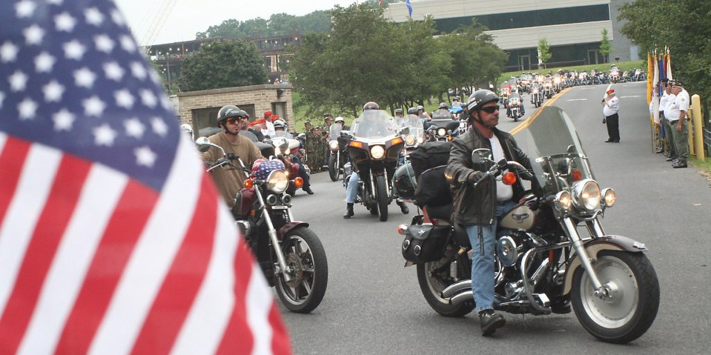 In this Aug. 17, 2007, photo, motorcyclists enter Allegany College of Maryland in Cumberland, Md., for a regrouping stop as they participate in the annual America's 9/11 Ride.  (John A. Bone/Cumberland Times-News via AP)