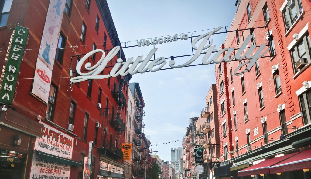 A sign welcomes visitors to Little Italy, at the corner of Broome and Mulberry Streets. (AP Photo/Bebeto Matthews)
