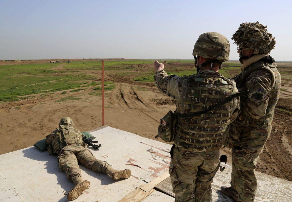 American and Spanish trainers in training exercises at Basmaya base, 25 miles southeast of Baghdad, Iraq, in Jan. 2016. (AP Photo/Karim Kadim, File)