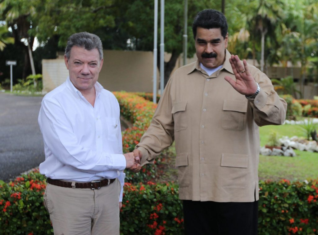 Venezuela's President Nicolas Maduro, right, and Colombian counterpart Juan Manuel Santos, pose for photos after Santos arrived for their meeting in Puerto Ordaz, Venezuela, Thursday, Aug. 11, 2016. The two South American leaders met Thursday to assess the situation on the Venezuelan-Colombian border, and to discuss the possibility of reopening of border crossings closed now for almost a year. (AP Photo/Fernando Llano)