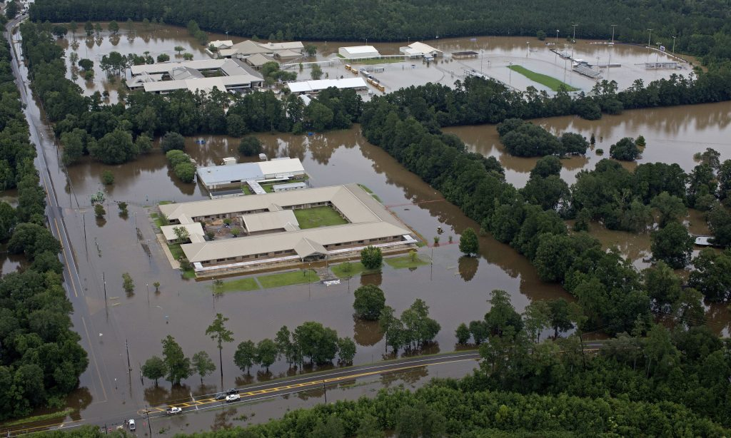 This aerial photo over Hammond, La., shows flooded Hammond Eastside Elementary Magnet School and Hammond High Magnet School after heavy rains inundated the region on Saturday. (AP Photo/Max Becherer)
