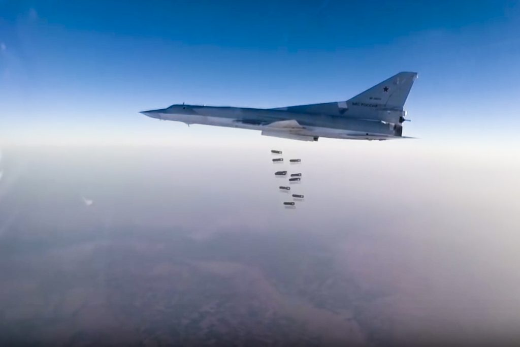 In this frame grab from video provided by the Russian Defense Ministry's press service, Russian long-range bomber Tu-22M3 flies during a strike above an undisclosed location in Syria on Sunday. (Russian Defense Ministry press service photo via AP)