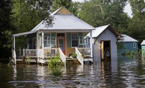 Floodwaters reach the front steps of a home near Holden, La., on Sunday. (AP Photo/Max Becherer)
