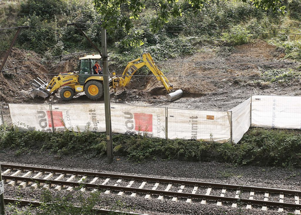 Heavy machinery begins the search, the work of explorers hoping to find a legendary Nazi train laden with treasure and armaments in Walbrzych, Poland, on Tuesday Aug. 16, 2016. The search attests to the power of a local legend claiming a Nazi 'gold' train disappeared in a mountain tunnel as the Germans escaped the advancing Soviet army at the end of World War II. (AP Photo/Czarek Sokolowski)