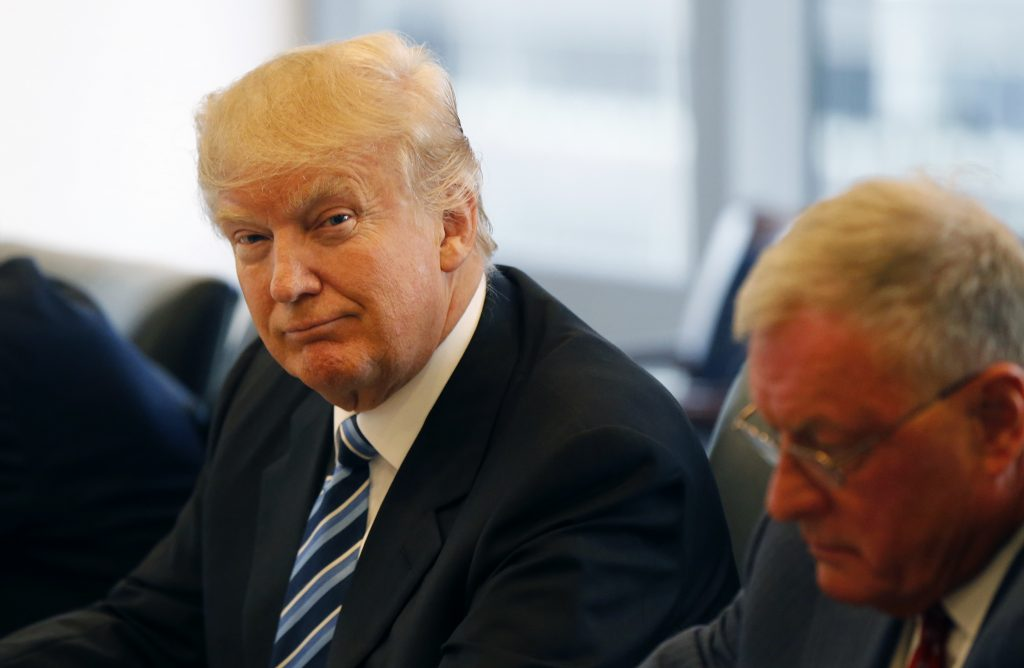 Republican presidential candidate Donald Trump participates in a roundtable discussion on national security in his offices in Trump Tower in New York, Wednesday, Aug. 17, 2016. At right is Ret. Army Lt. Gen. Keith Kellogg. (AP Photo/Gerald Herbert)