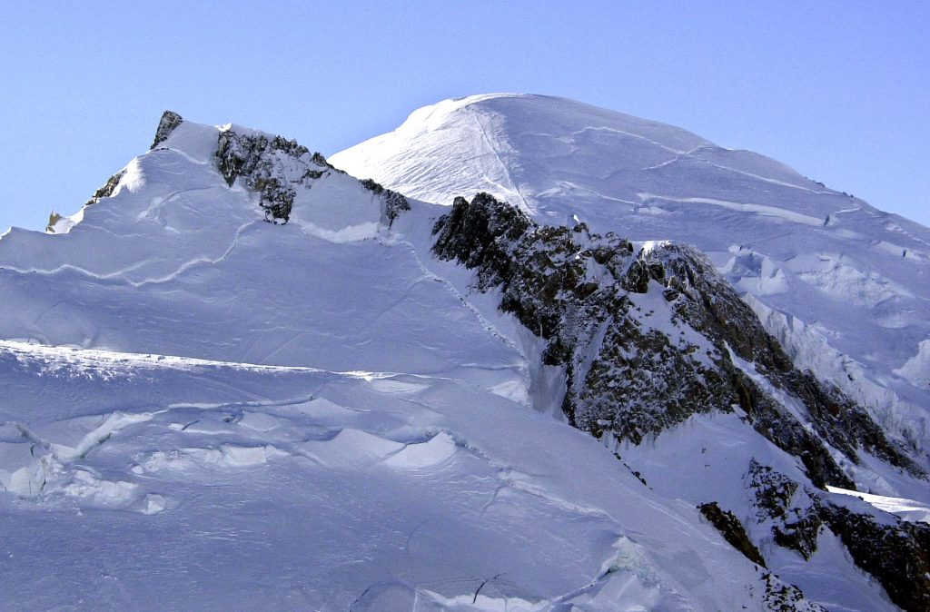 FILE - This Feb. 19, 2003 file photo shows Mont Blanc, western Europe's highest mountain. The mountain rescue team chief in the French town of Chamonix says Thursday Aug. 18 2016 that two women, a Slovakian and a Polish-British, and their German guide were climbing Mont Blanc's Mont Maudit at 4,100 meters (13,450 feet) when a tower of ice swept over them early Tuesday. The bodies of the three alpinists, have been found and dug out from the thick ice. (AP Photo/Patrick Gardin, File)