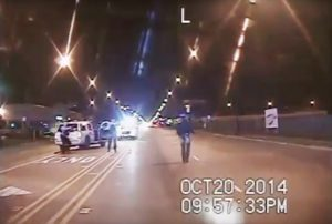 In this Oct. 20, 2014 frame from dash-cam video provided by the Chicago Police Department, Laquan McDonald, right, walks down the street moments before being fatally shot by officer Jason Van Dyke sixteen times in Chicago. (Chicago Police Department via AP File)