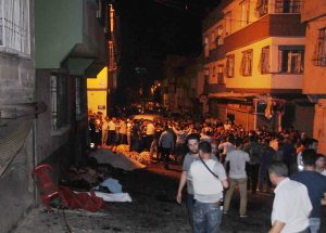 People gather after an explosion in Gaziantep, southeastern Turkey, early Sunday. (Eyyup Burun/DHA via AP)e