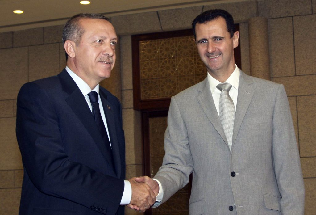 FILE - In this Oct. 11, 2010 file photo, Syrian President Bashar Assad, right, shakes hands with then Turkish Prime Minister Recep Tayyip Erdogan, at al-Shaab presidential palace in Damascus, Syria. For five years fighting has raged in Syria -- a globally resonant nightmare kept going in part by the insistence of Bashar Assad's opponents that he must go even though they were failing to dislodge him from power. Now an inflection point may finally be at hand, with increasingly important Turkey suggesting Assad could play a role in an unspecified transition period. (AP Photo/Bassem Tellawi, File)