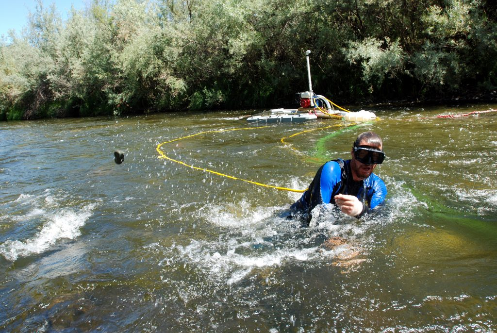 In this 2009 photo, Matt Lauer of Portage, Wis., works a suction dredge to hunt for gold in the Klamath River near Happy Camp, Calif. (AP Photo/Jeff Barnard, File)