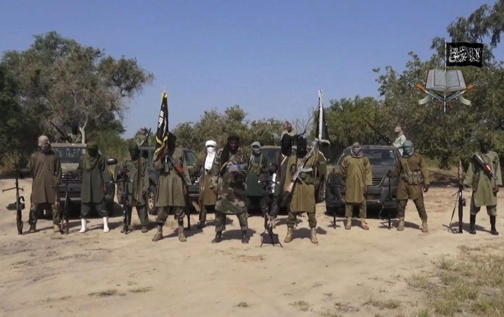 Abubakar Shekau, center, speaking, in an   image taken from video released in 2014 by Boko Haram. (AP Photo/Boko Haram,File)
