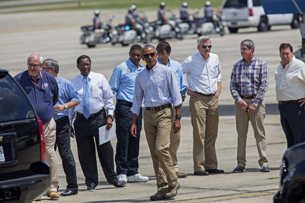 President Barack Obama on the tarmac after arriving on Air Force One at the Baton Rouge Metropolitan Airport on Tuesday. From left are, FEMA Administrator Craig Fugate, Gonzales, La. Mayor Barney Arceneaux, Baton Rouge, La. Mayor Kip Holden, Rep. Cedric Richmond, D-La., Rep. Garret Graves, R-La., Sen. Bill Cassidy, R-La., Sen. David Vitter, R-La., and Louisiana Lt. Gov. Billy Nungesser. (AP Photo/Max Becherer)