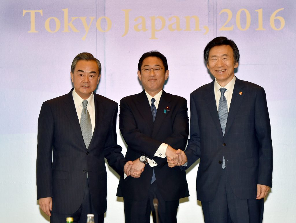 Japanese Foreign Minister Fumio Kishida, center, Chinese Foreign Minister Wang Yi, left, and South Korean Foreign Minister Yun Byung-se pose for the photographers before their trilateral meeting in Tokyo, Wednesday, Aug. 24, 2016. The foreign ministers of China, Japan and South Korea have criticized North Korea's fresh missile launch just hours earlier in the day. (Katsumi Kasahara/Pool Photo via AP)