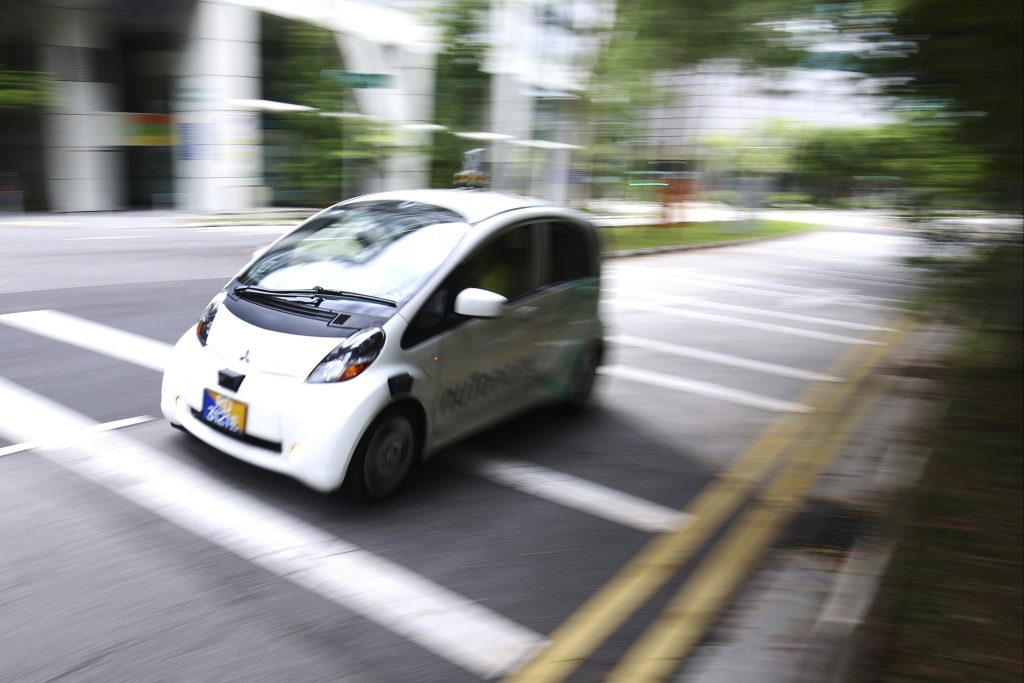 An autonomous vehicle is driven during its test drive in Singapore Wednesday, Aug. 24, 2016. The world's first self-driving taxis, operated by nuTonomy, an autonomous vehicle software startup, will be picking up passengers in Singapore starting Thursday, Aug. 25. The service will start small - six cars now, growing to a dozen by the end of the year. The ultimate goal, say nuTonomy officials, is to have a fully self-driving taxi fleet in Singapore by 2018, which will help sharply cut the number of cars on Singapore's congested roads. (AP Photo/Yong Teck Lim)