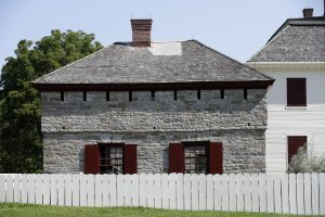 The restored stone house is seen at Johnson Hall State Historic Site. (AP Photo/Mike Groll)