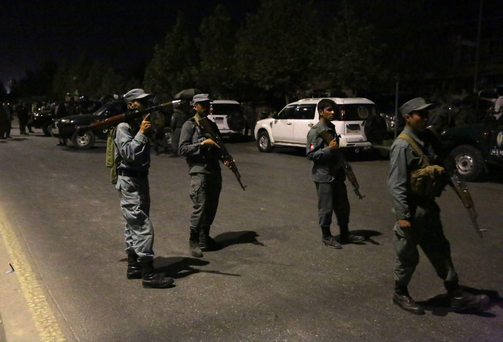 Afghan security forces respond to the attack on the campus of the American University in Kabul on Wednesday. (AP Photo/Rahmat Gul)