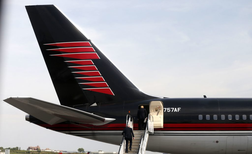 Republican presidential candidate Donald Trump boards his plane at LaGuardia Airport in New York, Thursday, Aug. 25, 2016. (AP Photo/Gerald Herbert)