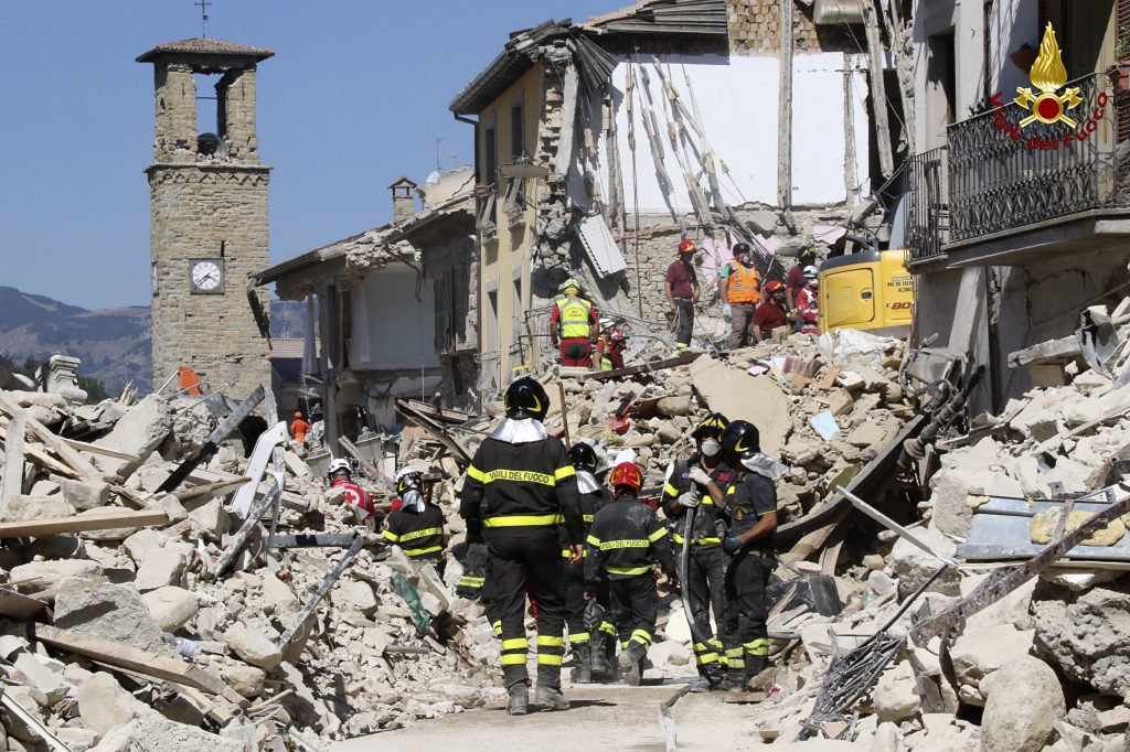 Rescuers work amid collapsed buildings in Amatrice, Italy, on Thursday. (Italian Firefighters Vigili del Fuoco via AP)