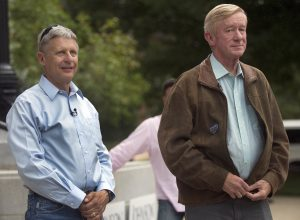Libertarian presidential candidate Gary Johnson, left, stands with his vice presidential running mate, former Massachusetts governor William Weld, during a campaign rally , in Concord, N.H., on Thursday. (AP Photo/Jim Cole)