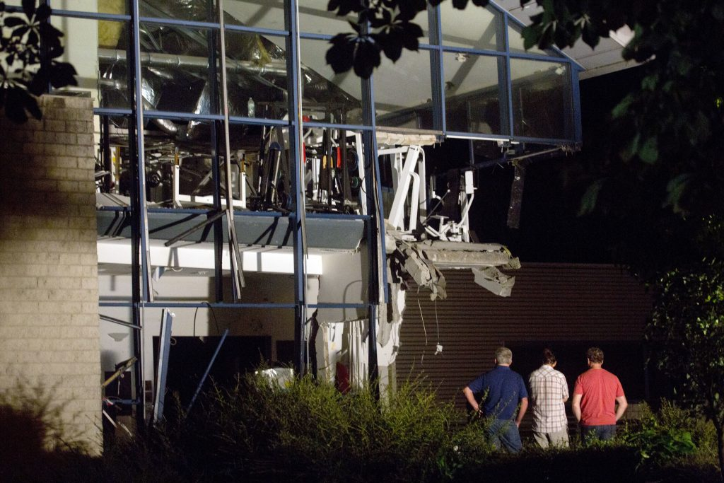 Police inspectors survey the scene of a blast at a sports complex in Chimay, Belgium, Friday, Aug. 26, 2016. One person is reported to have been killed and at least two injured in an accidental explosion at a sports center near the French border. (AP Photo/Virginia Mayo)