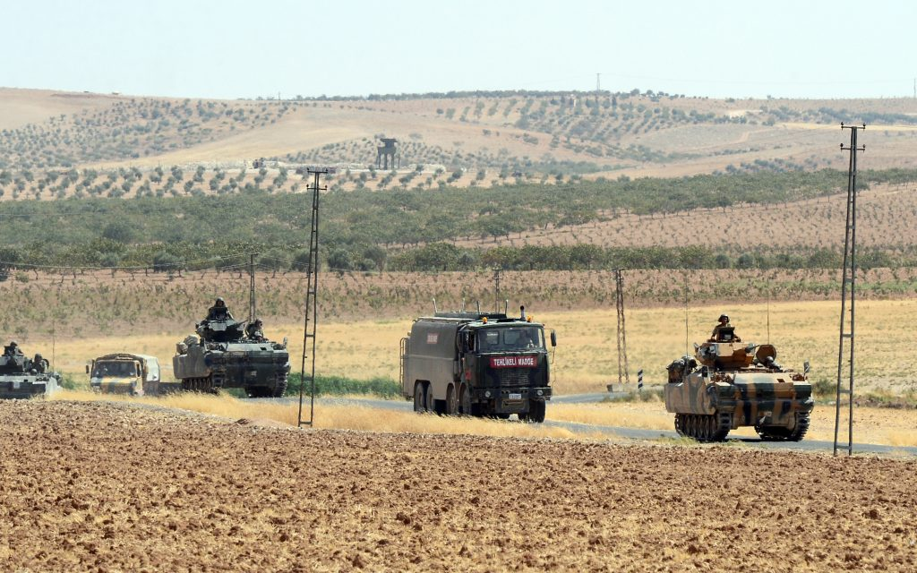 Turkish troops return from the Syrian border, in Karkamis, Turkey, on  Saturday, Aug. 27, 2016. Turkey on Wednesday sent tanks across the border to help Syrian rebels retake the key Islamic State-held town of Jarablus and to contain the expansion of Syria's Kurds in an area bordering Turkey. (Ismail Coskun, IHA via AP)