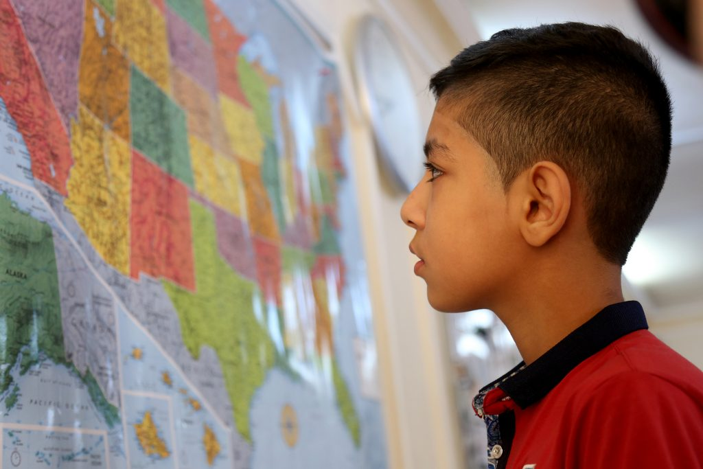AMMAN, Jordan _ In this photo taken Sunday, August 28, 2016, Syrian refugee Hamzeh Jouriyeh, 12, studies a map of the United States in the Amman, Jordan office of the International Organization for Migration. Jouriyeh, his three siblings and his parents are heading to San Diego, California early Monday, as part of a year-long program to resettle 10,000 Syrian refugees in the United States.(AP Photo/Raad Adayleh)