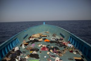 Belongings left behind by migrants are seen in the floor of a wooden boat. (AP Photo/Emilio Morenatti)