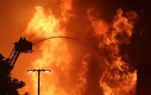 A firefighter battles the blaze. (Frank Becerra Jr./The Journal News via AP)