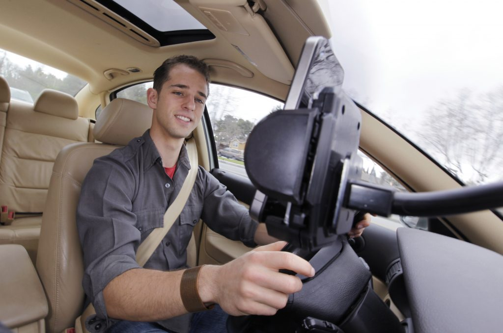 FILE - In this March 15, 2012 file photo, Ben Gleitzman uses a traffic and navigation app called Waze as he drives to work in Menlo Park, Calif. (AP Photo/Paul Sakuma, File)