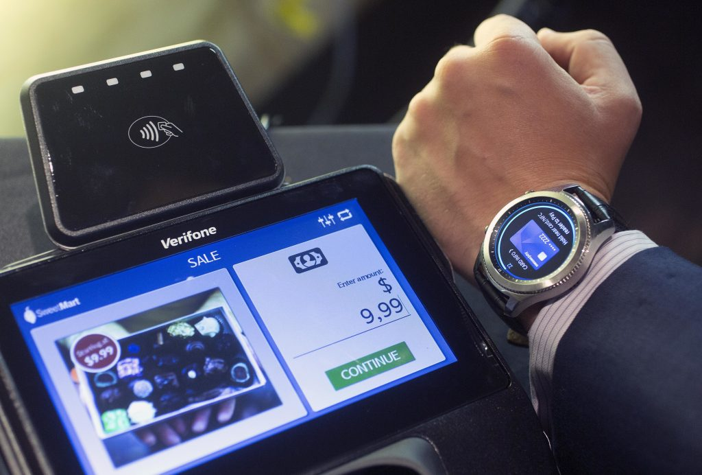 In this Aug. 25, 2016, photo, the Samsung S3's Samsung Pay feature is demonstrated in New York. The smartwatch comes with expanded ability to make payments at stores. As a result, there's now PIN protection on the watch, though it isn't automatically activated until the user sets up Samsung Pay. (AP Photo/Mark Lennihan)