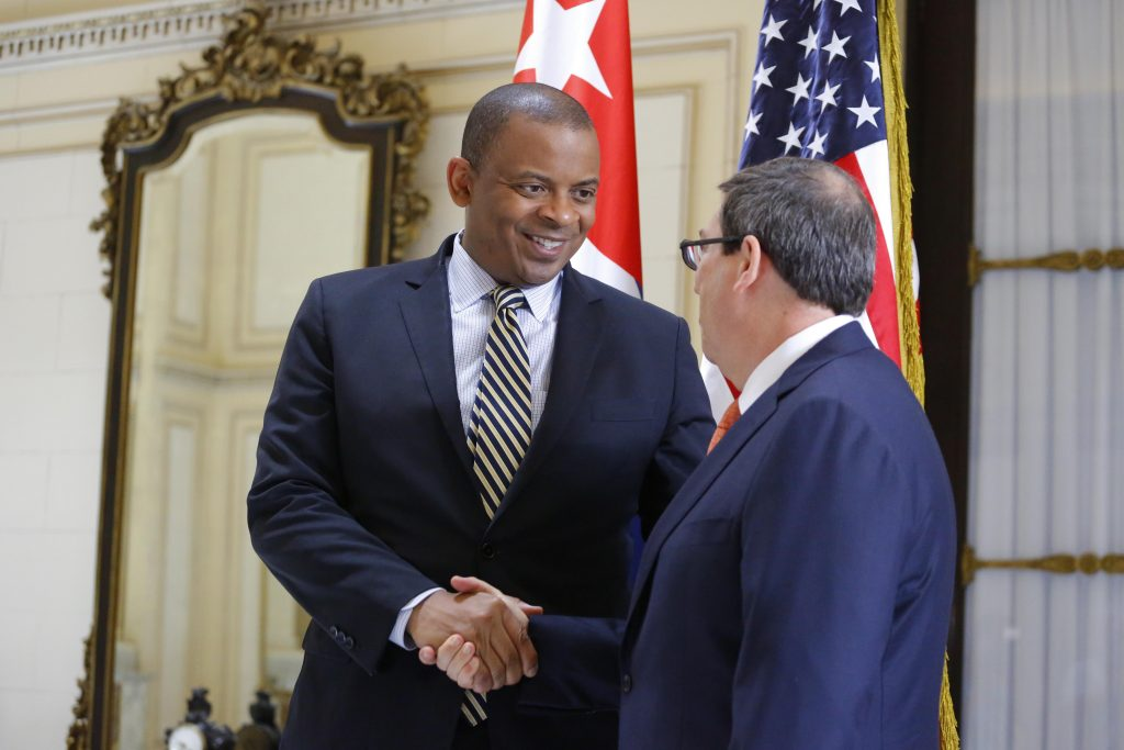 U.S. Transportation Secretary Anthony Foxx (left) shakes hands with Cuba's Foreign Minister Bruno Rodriguez in Havana on Wednesday. (AP Photo/Desmond Boylan)
