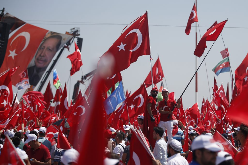 Thousands of people attend a Democracy and Martyrs' Rally in Istanbul, Sunday. (AP Photo/Emrah Gurel)