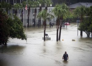 A resident wades through floodwater in Baton Rouge, La., on Saturday. (Brianna Paciorka/The Advocate via AP)