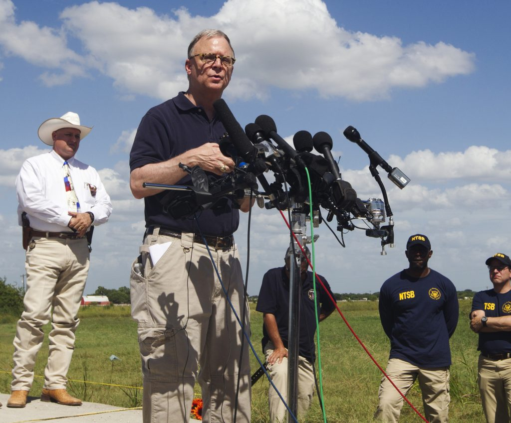 NTSB member, Robert Sumwalt speaks at a press conference at the site of Saturday's hot air balloon crash near Lockhart, Texas, Sunday, July 31, 2016. A hot air balloon made contact with high-tension power lines before crashing into a pasture in Central Texas, killing all on board, according to federal authorities who are investigating the worst such disaster in U.S. history. (Jessalyn Tamez/Austin American-Statesman via AP)