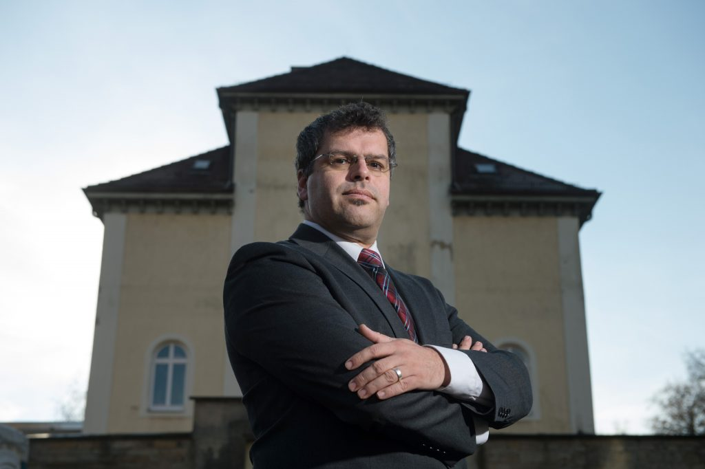 FILE - In this Nov. 24, 2015 file picture  Jens Rommel, the head of a special prosecutors' office that looks into Nazi war crimes,poses in Ludwigsburg, Germany. German prosecutors say they have tracked down eight people who allegedly worked at the Nazis' Stutthof concentration camp during World War II and are considering whether they can be charged as accessories to murder. Jens Rommel, the head of a special prosecutors' office that looks into Nazi war crimes, told news agency dpa on Tuesday Aug. 9, 2016  that four male suspects worked as guards and four women were secretaries or telephone operators.   (Marijan Murat/dpa via AP,file)