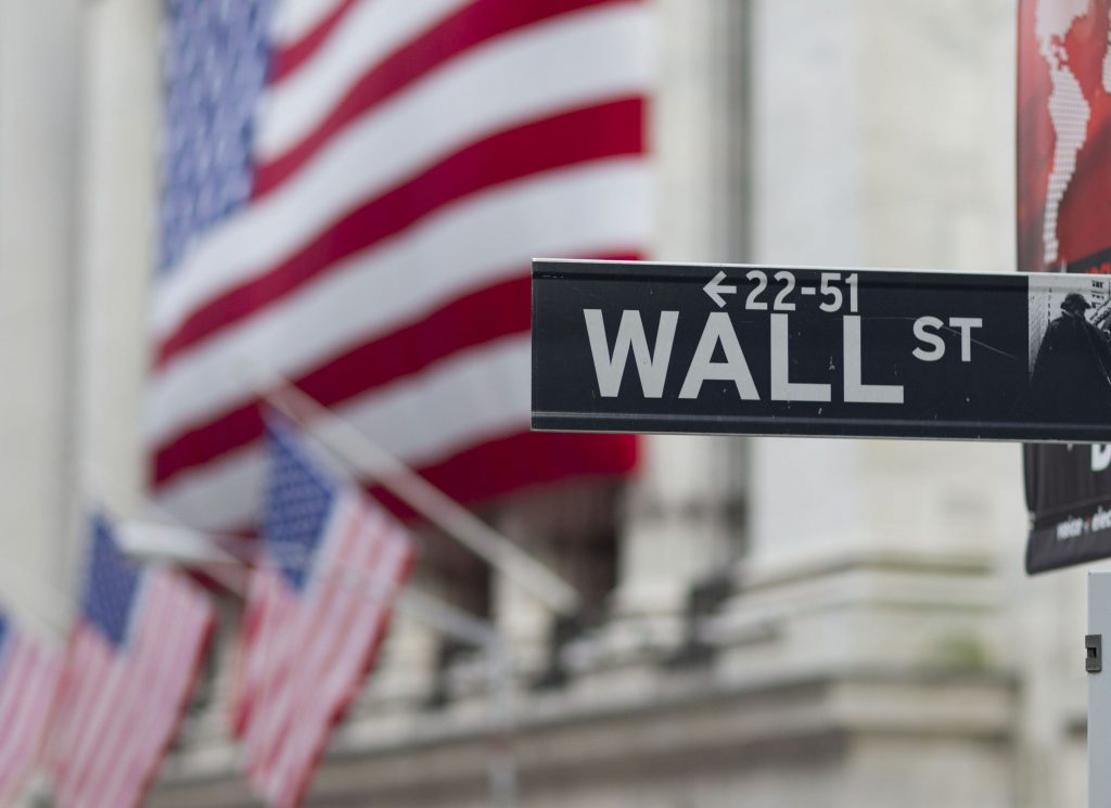 FILE - In this Aug. 8. 2011 file photo, a Wall Street sign hangs near the New York Stock Exchange, in New York. (AP Photo/Jin Lee, File)