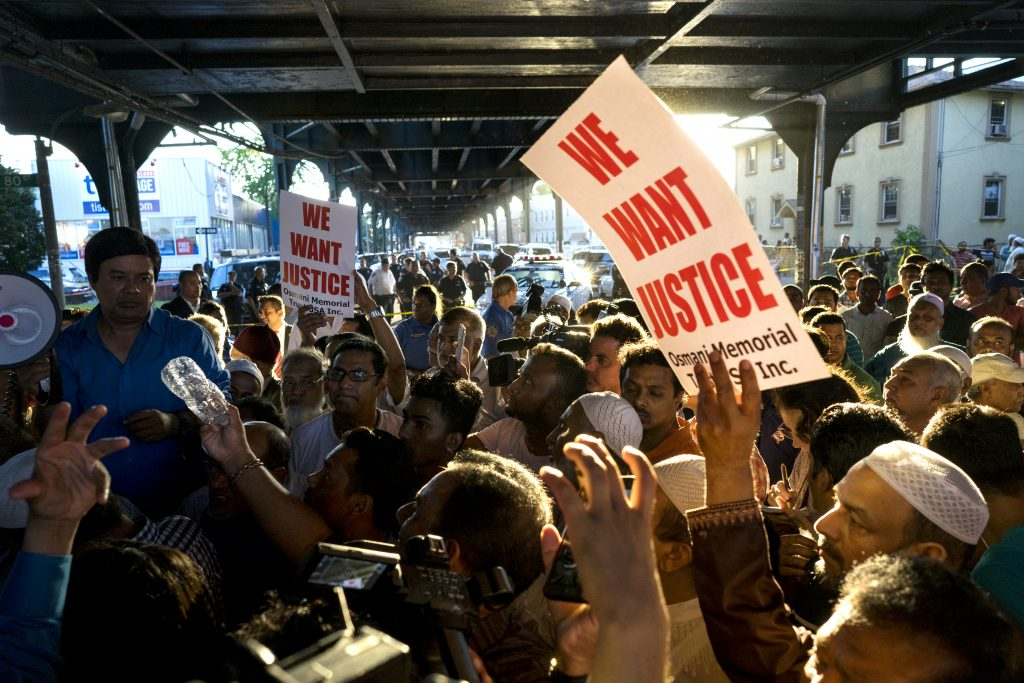 A demonstration in Queens on Saturday, after Imam Maulama Akonjee and Tharam Uddin were shot as they left the Al-Furqan Jame Masjid mosque. (AP Photo/Craig Ruttle)