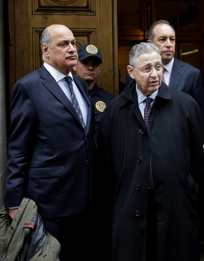 Former Assembly Speaker Sheldon Silver, front right, leaves court in New York after his conviction on May 3, 2016. On Silver's right is his attorney Joel Cohen; behind Silver is his attorney Steven Molo. (AP Photo/Seth Wenig)