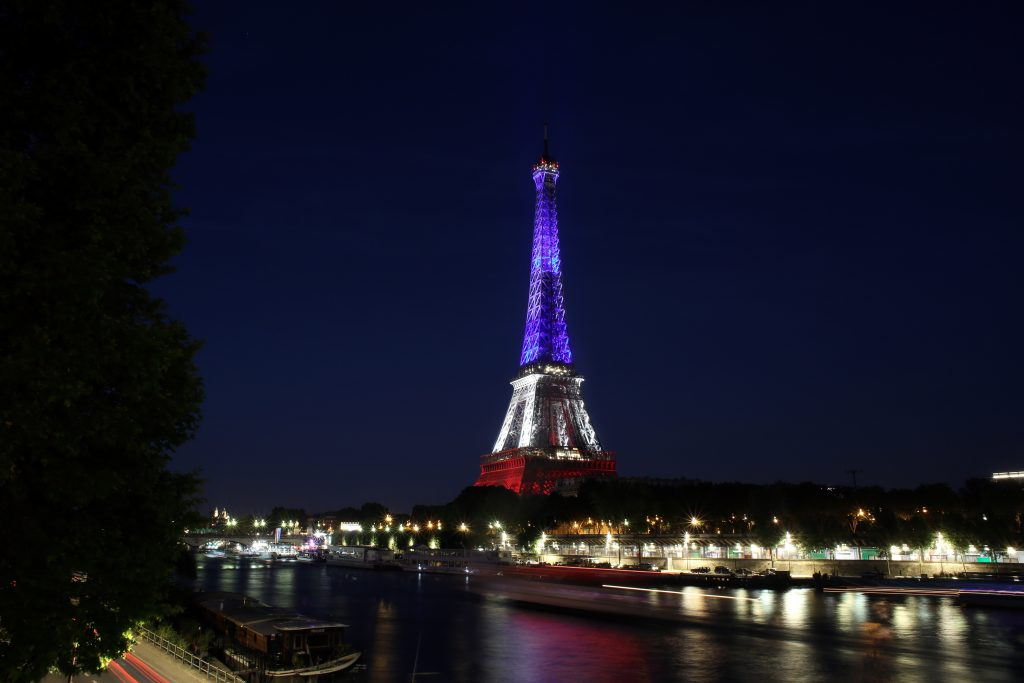The Eiffel Tower is illuminated in the French national colors. (AP Photo/Thibault Camus)