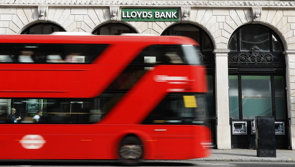 A bus passes a branch of Lloyds Bank in London. (AP Photo/Kirsty Wigglesworth)