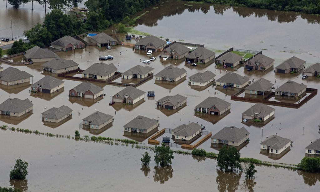 Flooded homes in Hammond, La., on Saturday. (AP Photo/Max Becherer)
