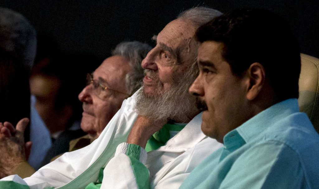 Cuban Leader Fidel Castro, center, attends a gala for his 90th birthday accompanied by Cuba's President Raul Castro, left, and Venezuela's President Nicolas Maduro, right, at the Karl Marx theater in Havana, Cuba, on Aug. 13. (Ismael Francisco, Cubadebate via AP)