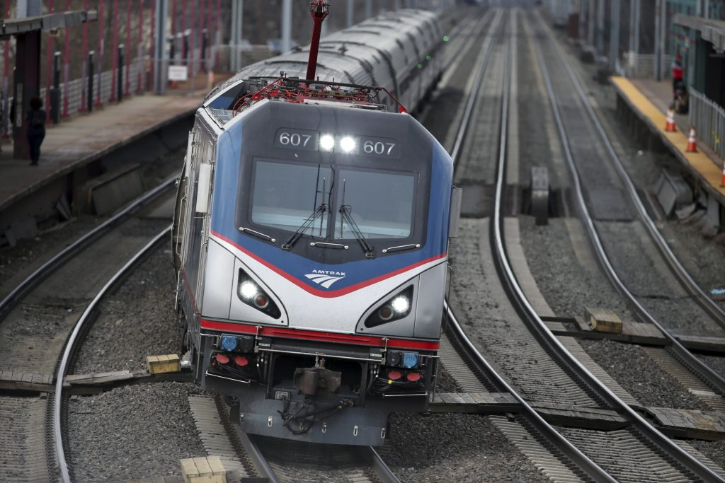 An Amtrak train passes through Elizabeth train station in Elizabeth, N.J., along Amtrak's Northeast Corridor. (AP Photo/Mel Evans)