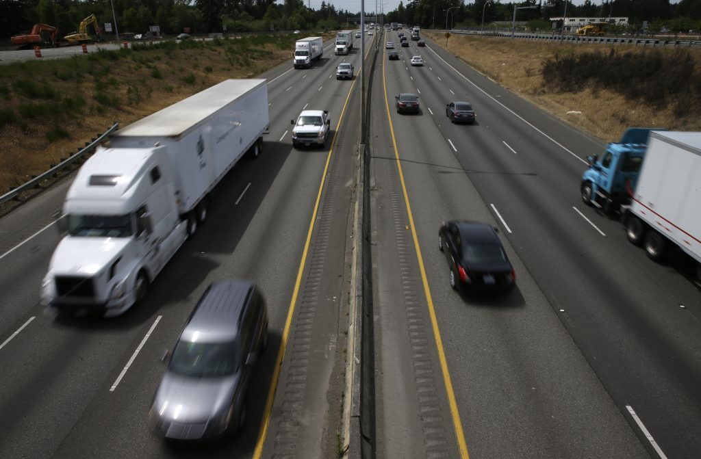 Cars and trucks move along Interstate 5, in Lakewood, Wash. Washington state. (AP Photo/Ted S. Warren)